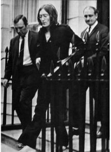 John being led away by the police from Montagu Square