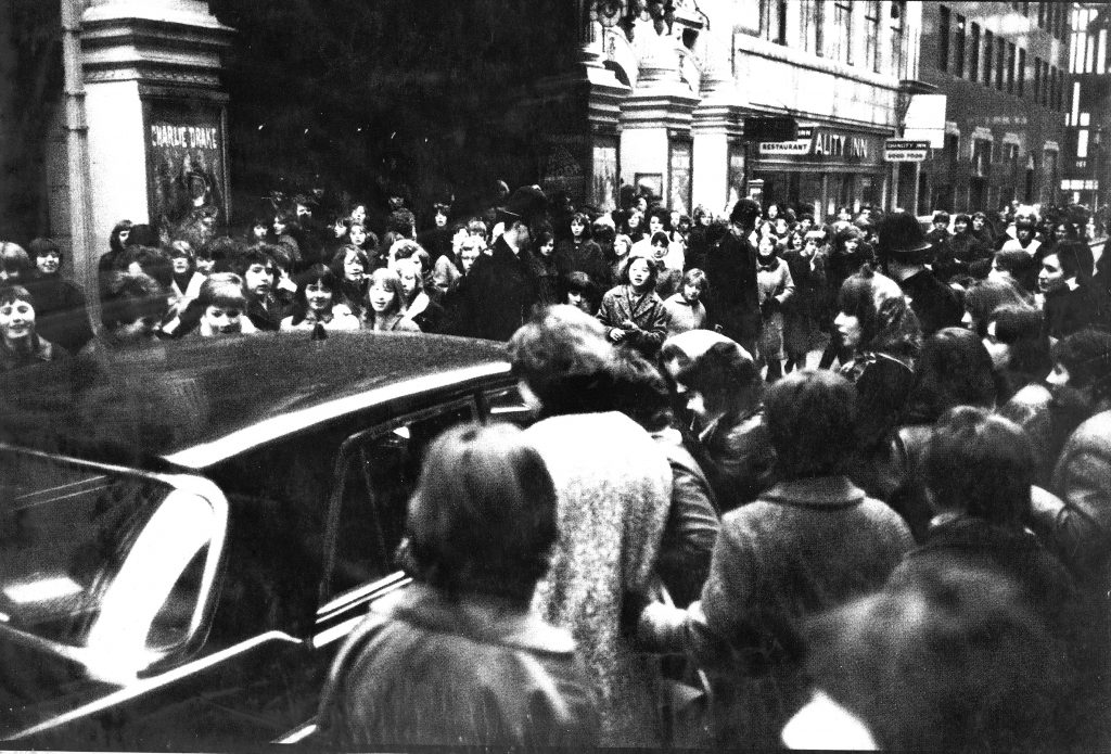 Fans crowd Argyll Street waiting to see the Beatles