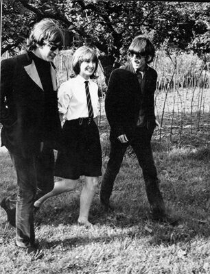 John Lennon and George Harrison in Chiswick House Park with a fan
