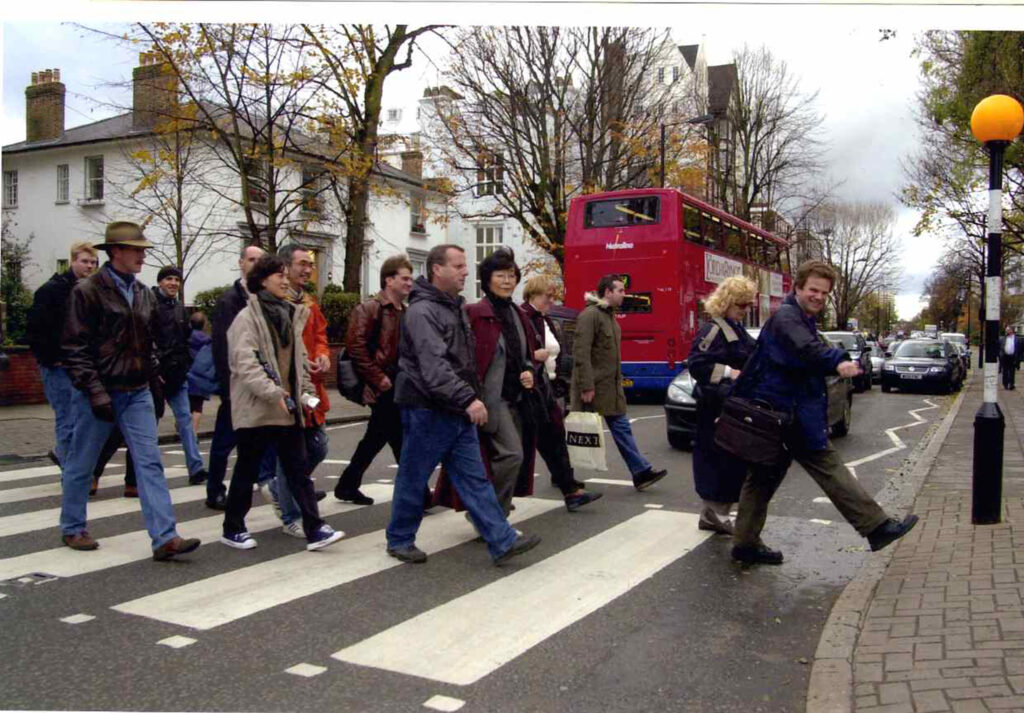 Guide Richard Porter leading his London Beatles Walk group across Abbey Road