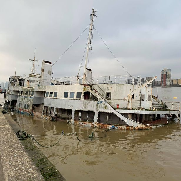 The Royal Iris Mersey Ferry nearly submerged in the River Thames