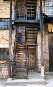 Richard Porter on the Fire escape of Hammersmith Odeon - as used by The Beatles in A Hard Day's Night