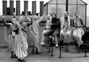 George Harrison with members of the Radha Krishna Temple on the roof of 3 Savile Row, London